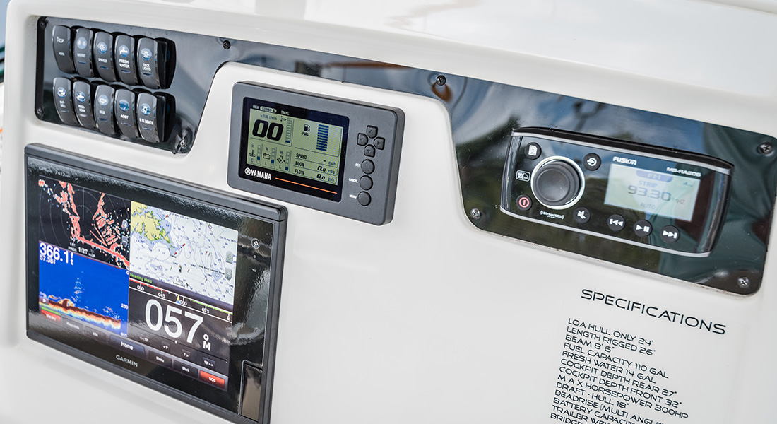 241 Center Console - Closeup of Helm with Garmin GPS, Yamaha Engine Monitor, Fusion Stereo and Switch Panel