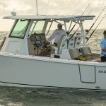 Aft Portside view of gentlemen fishing from a Sailfish Center Console boat